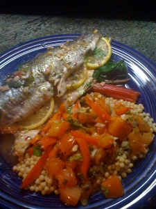Whole trout with rainbow chard and roasted tomato-caper salsa over cous cous