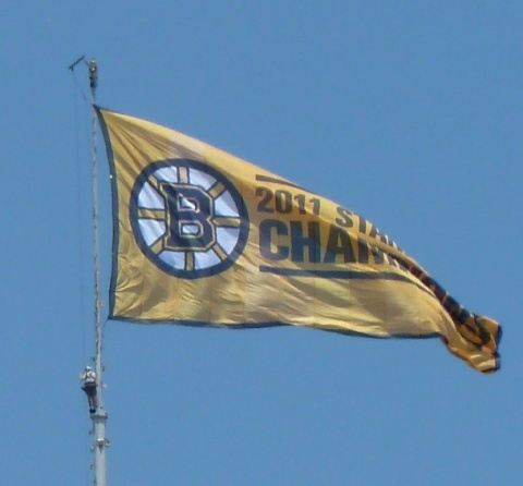 Bruins flag on Hancock Building with man underneath