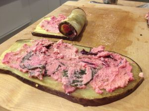 Eggplant slices spread with ricotta mixture and rolled.