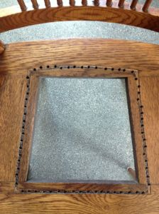 Seat with holes drilled around the opening's perimeter.