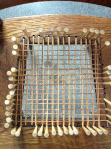 Weaving the second horizontal strip.